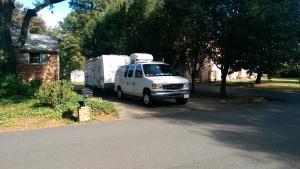 Van and camper leaving driveway