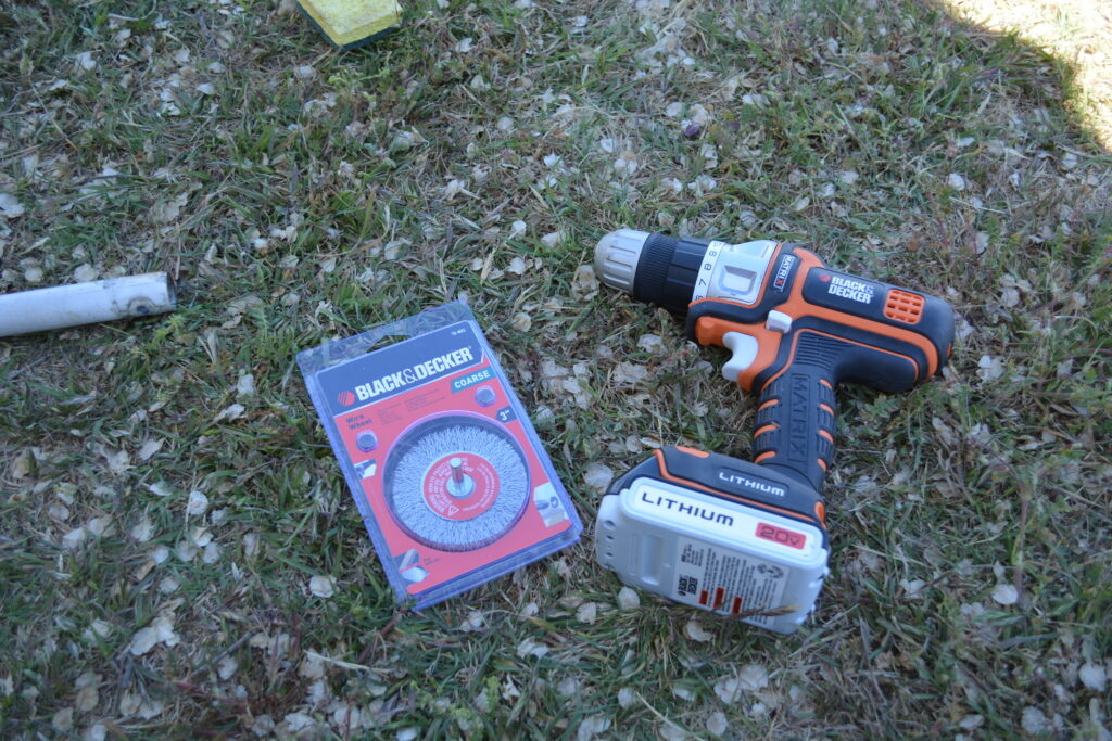 You'll want to remove any rust/oxidation, and knock off any blemishes that would make a bump in your new paint. We used our freaking awesome Black & Decker Matrix Drill, and a Black & Decker wire brush attachment. Black & Decker - if you're reading this, we use a lot of your stuff. You should consider sponsoring... Just saying.